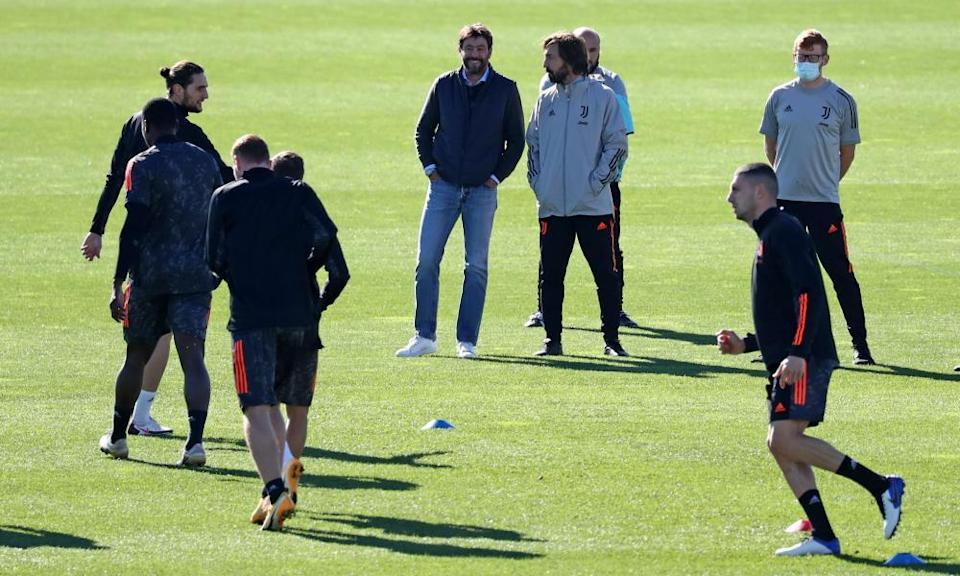 Andrea Agnelli, Juventus's CEO, talks to Andrea Pirlo at training for a Champions League game against Barcelona in October 2020