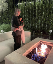 <p>Another gorgeous location, another hug. </p><p>This time, Donaldson points out, Kourtney is folding her body into Travis while he kisses her on the head. Like most of their hugs, it's intimate, but this one shows Kourtney and Travis care about each other. This relationship is much more than the sexual, it's also tender, says Donaldson.<br></p>