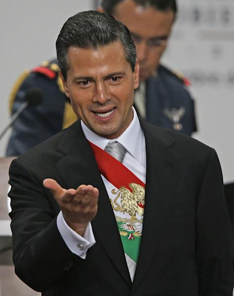Mexico's President Enrique Pena Nieto gestures after delivering his first state-of-the-nation address at the Los Pinos presidential residence in Mexico City, Monday Sept. 2, 2013. Pena Nieto used much of his address to celebrate a victory in education reform that had threatened to derail the legislative agenda he has pushed since taking office Dec. 1. (AP Photo/Dario Lopez-Mills)