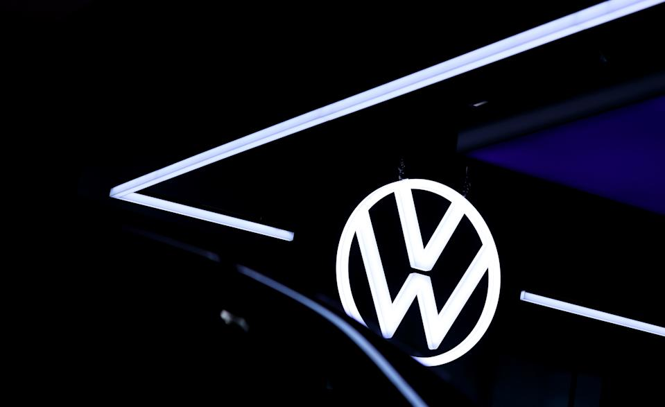 The VW Logo is reflected in a new Volkswagen (VW) ID.3 electric automobile at the headquarters of German car maker Volkswagen in Wolfsburg on October 26, 2020. (Photo by Ronny Hartmann / AFP) (Photo by RONNY HARTMANN/AFP via Getty Images)