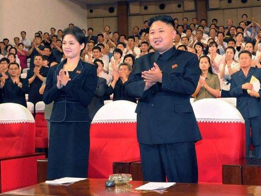 This picture taken on July 6, shows North Korean leader Kim Jong Un and a mystery woman enjoying a performance by the Moranbong band in Pyongyang. A smartly dressed woman seen with Kim Jong-Un at recent public events has again been shown on state television accompanying the North Korean leader, increasing speculation that she could be his wife