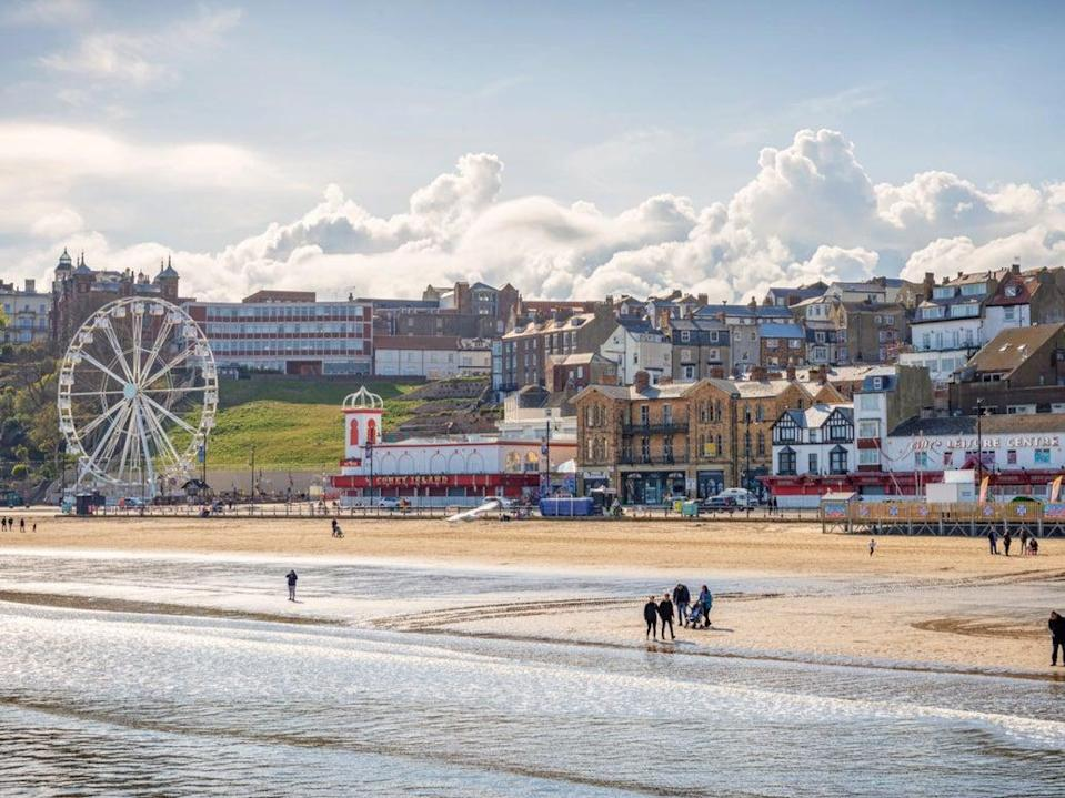 People enjoying the beach at Scarborough in the sunshine (Getty Images)