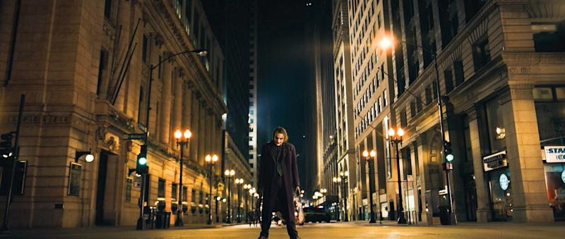 "FILE - In this undated image released by Warner Bros., Heath Ledger is shown in a scene from, ""The Dark Knight.""  in the decade since Sept. 11, movies have turned dark, paranoid and questioning. Even in the most popular films of the decade, a post-9/11 atmosphere is unmistakable.  (AP Photo/Warner Bros.)"