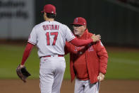 Los Angeles Angels pitcher Shohei Ohtani (17) is taken out of the baseball game by manager Joe Maddon during the seventh inning against the Oakland Athletics on Friday, May 28, 2021, in Oakland, Calif. (AP Photo/Tony Avelar)