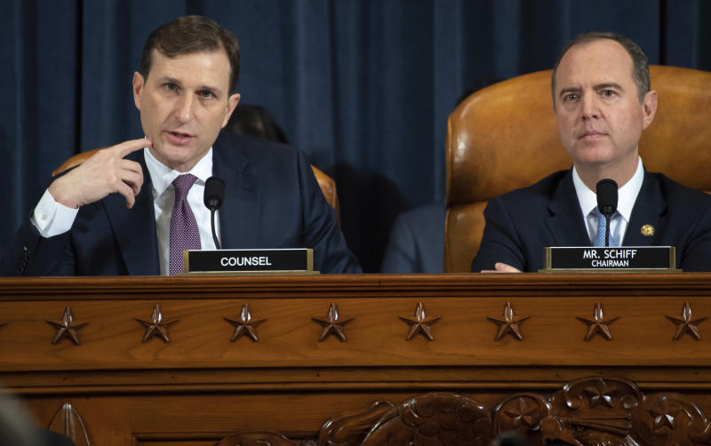 Daniel Goldman, director of investigations for the House Intelligence Committee majority staff, left, asks questions to top U.S. diplomat in Ukraine William Taylor and career Foreign Service officer George Kent, as they testify before the House Intelligence Committee on Capitol Hill in Washington, Wednesday, Nov. 13, 2019, during the first public impeachment hearing of President Donald Trump's efforts to tie U.S. aid for Ukraine to investigations of his political opponents. House Intelligence Committee Chairman Rep. Adam Schiff, D-Calif., right, looks on. (Saul Loeb/Pool Photo via AP)
