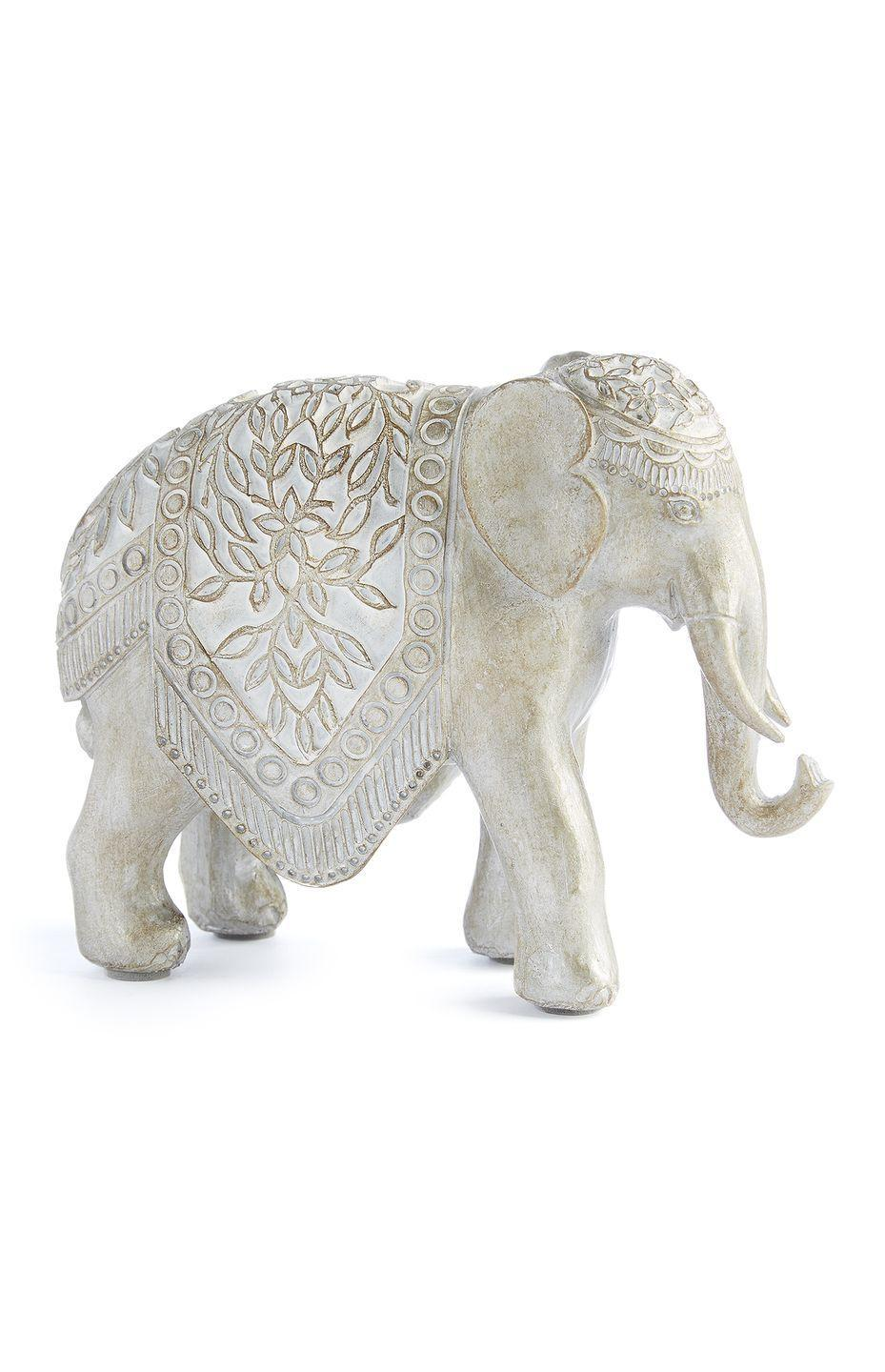 <p>Elephant ornament in gold, price unknown</p>
