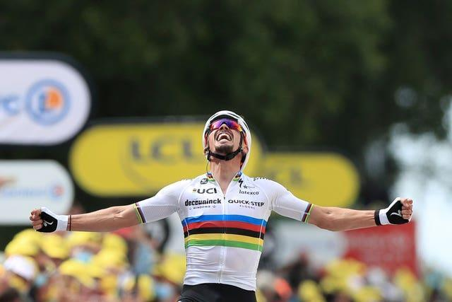 France's Julien Alaphilippe celebrates winning the first stage of the Tour de France, which was marred by two big crashes in the peloton