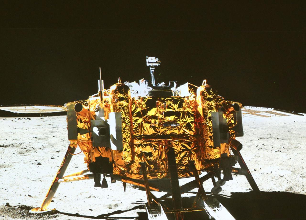 "This image taken by the on-board camera of the ""Yutu"" or ""Jade Rabbit"" rover, and made off the screen of the Beijing Aerospace Control Center in Beijing on Sunday, Dec. 15, 2013, shows a photo of the Chang'e-3 lander during the mutual-photograph process. The rover and the lander took photos of each other Sunday night, marking the success of the Chang'e-3 lunar probe mission. (AP Photo/Xinhua, Ding Lin) NO SALES"