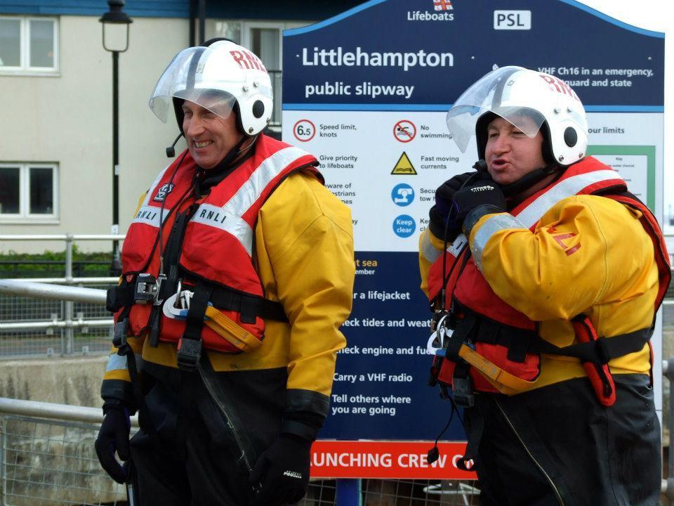 Andy Harris (left) and fellow helm Ivan Greer (right) in full lifesaving kit prepare for a training session pre-Covid (RNLI/PA)