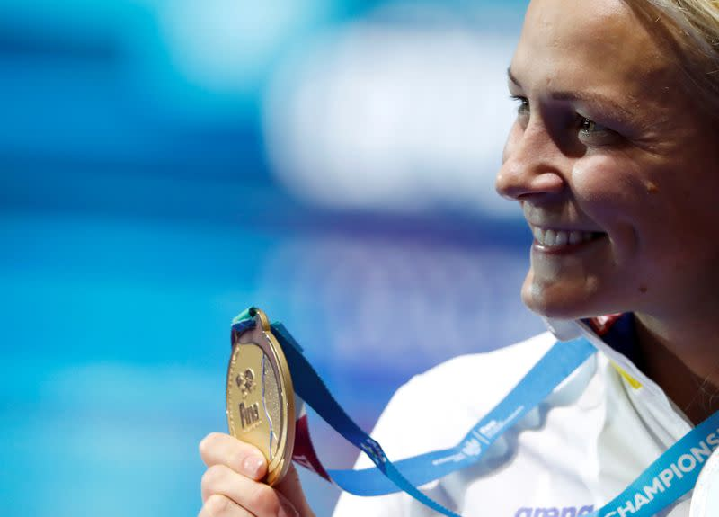 FILE PHOTO: Sarah Sjostrom of Sweden poses with her gold medal at the 2017 World Aquatics Championships