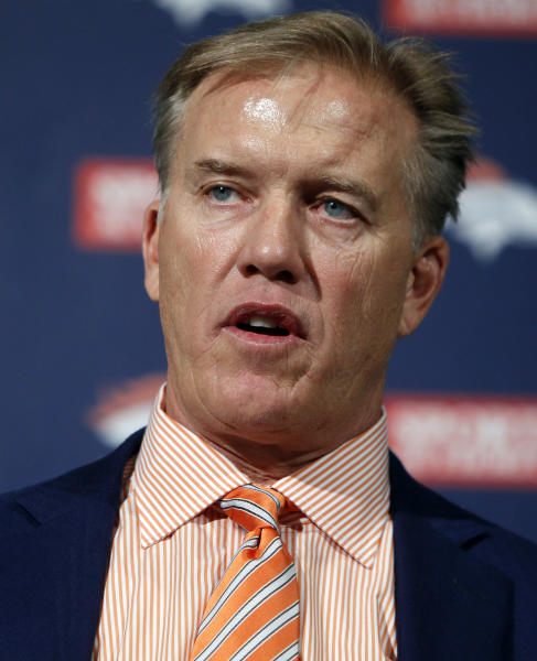 FILE - This April 26, 2012 file photo shows Denver Broncos vice president John Elway talking about the NFL football draft at the Denver Broncos headquarters in Englewood, Colo., on April 26, 2012. Elway is turning the Broncos into winners again. As recently as two years ago, they were dissolving into irrelevance. The centerpiece of the turnaround, of course, was the signing of Peyton Manning.(AP Photo/Ed Andrieski, File)