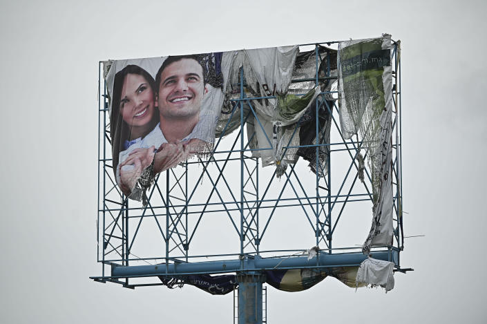 A billboard is damaged after the passing of Hurricane Pamela in Mazatlan, Mexico, Wednesday, Oct. 13, 2021. Pamela made landfall on Mexico's Pacific coast just north of Mazatlan on Wednesday, bringing high winds and rain to the port city. (AP Photo/Roberto Echeagaray)