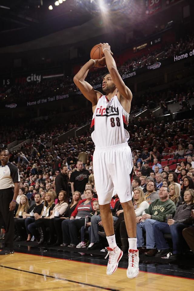PORTLAND, OR - MARCH 5: Nicolas Batum #88 of the Portland Trail Blazers shoots against the Atlanta Hawks on March 5, 2014 at the Moda Center Arena in Portland, Oregon. (Photo by Cameron Browne/NBAE via Getty Images)