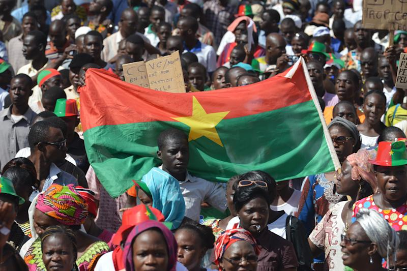 Residents take part in a march to protest against the cost of living in Ouagadougou, on October 29, 2014. (AFP Photo/Issouf Sanogo)