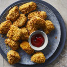 """<p>These crispy air-fried chicken nuggets are a quick kid-friendly dinner that parents will love too. The homemade nuggets are healthier than fast-food versions--and more flavorful, thanks to the cornflake coating. You can also cut the chicken into strips for air-fryer chicken tenders. Be sure to cook those 2 to 3 minutes longer, or until done.</p> <p> <a href=""""http://www.eatingwell.com/recipe/270213/air-fryer-chicken-nuggets/"""" rel=""""nofollow noopener"""" target=""""_blank"""" data-ylk=""""slk:View recipe"""" class=""""link rapid-noclick-resp""""> View recipe </a></p>"""
