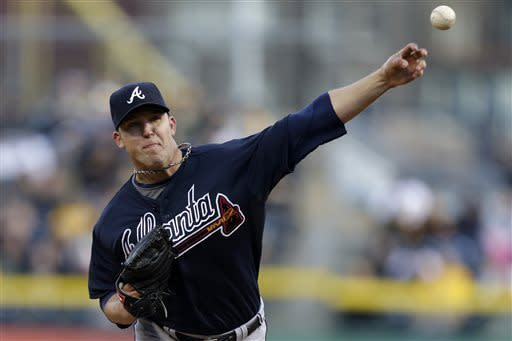 2Atlanta Braves starting pitcher Paul Maholm (28) delivers during the first inning of a baseball game against the Pittsburgh Pirates in Pittsburgh Saturday, April 20, 2013. (AP Photo/Gene J. Puskar)