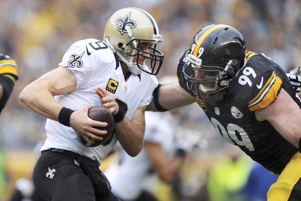 Pittsburgh Steelers defensive end Brett Keisel (99) pressures New Orleans Saints quarterback Drew Brees (9) in the first quarter of the NFL football game, Sunday, Nov. 30, 2014 in Pittsburgh. Brees got away. (AP Photo/Don Wright)