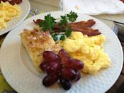 """<p><a href=""""https://www.tripadvisor.com/Hotel_Review-g60814-d118133-Reviews-Catherine_Ward_House_Inn-Savannah_Georgia.html"""" rel=""""nofollow noopener"""" target=""""_blank"""" data-ylk=""""slk:Catherine Ward House Inn"""" class=""""link rapid-noclick-resp"""">Catherine Ward House Inn</a> in Savannah</p><p>""""We ate breakfast and enjoyed pleasant conversation at the second seating with four other couples. There was orange juice and (delicious) coffee waiting when we arrived. Leslie and Sonya began delivering food which consisted of a banana and blackberry parfait, ham, eggs with cheese and mushrooms, seasoned potatoes, and some wonderful seasoned grape tomatoes."""" - Yelp user <a href=""""https://www.yelp.com/user_details?userid=rtYFV66huRJpGKUT2jDzmw"""" rel=""""nofollow noopener"""" target=""""_blank"""" data-ylk=""""slk:Mags B."""" class=""""link rapid-noclick-resp"""">Mags B.</a></p>"""