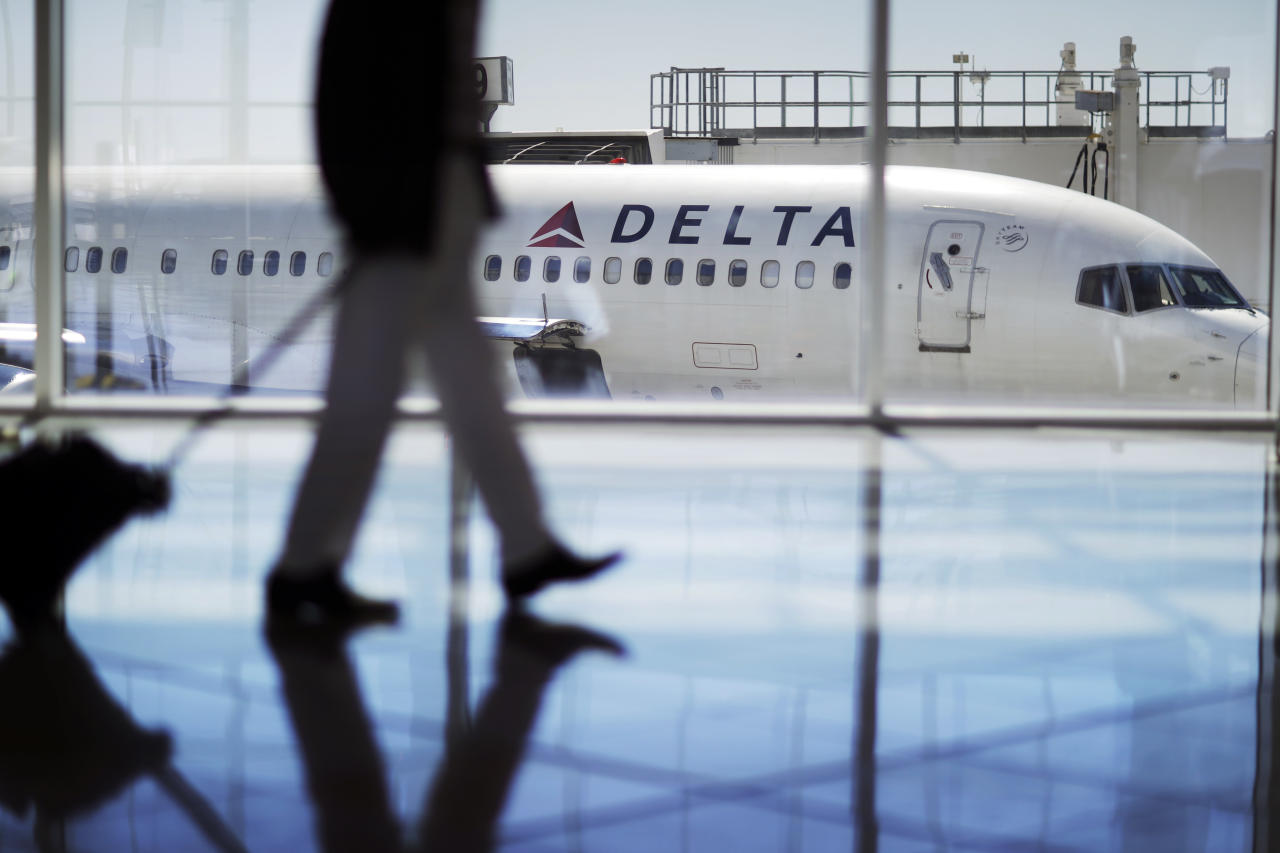 "<p> FILE - This Thursday, Oct. 13, 2016 file photo shows a Delta Air Lines jet at Hartsfield-Jackson Atlanta International Airport in Atlanta. The company says it's no longer allowing passengers to fly with ""pit bull type"" dogs as service or support animals, a policy that's being met with criticism by groups that train service dogs and the people who use them. The changes are scheduled to take effect July 10, 2018. (AP Photo/David Goldman) </p>"