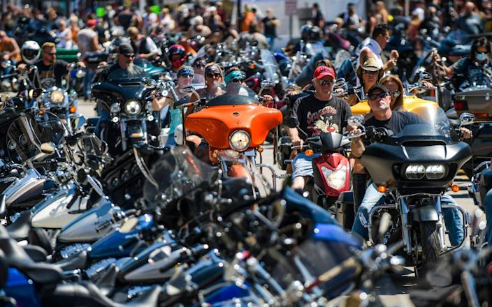Motorcyclists ride down Main Street during the 80th Annual Sturgis Motorcycle Rally - Michael Ciaglo/Getty Images
