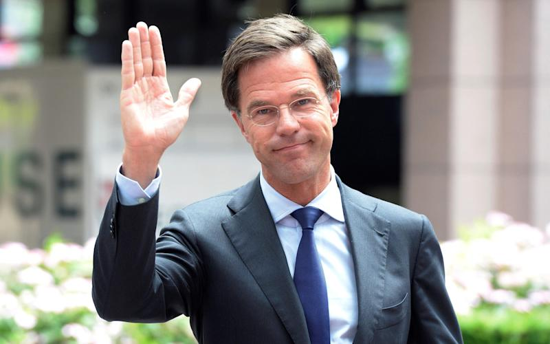 Dutch prime minister Mark Rutte waving to journalists as he arrives before an EU summit meeting at the European Union headquarters in Brussels - Credit:  AFP or licensors