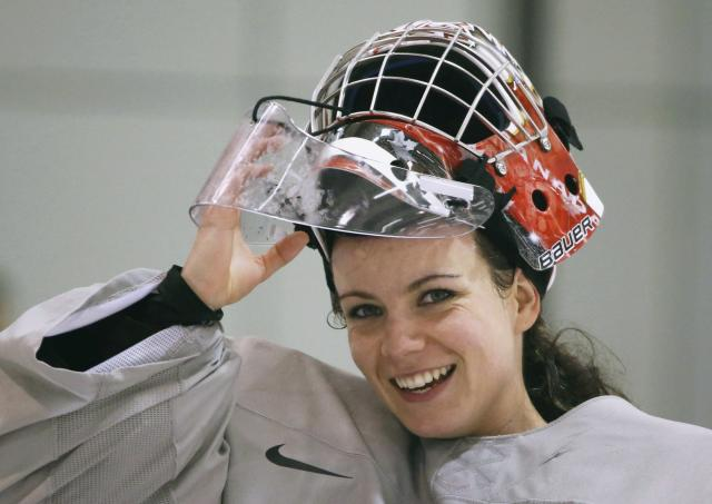 Canada's goalie Shannon Szabados smiles during a women's ice hockey team practice at the 2014 Sochi Winter Olympics February 19, 2014. REUTERS/Lucy Nicholson (RUSSIA - Tags: SPORT ICE HOCKEY OLYMPICS)