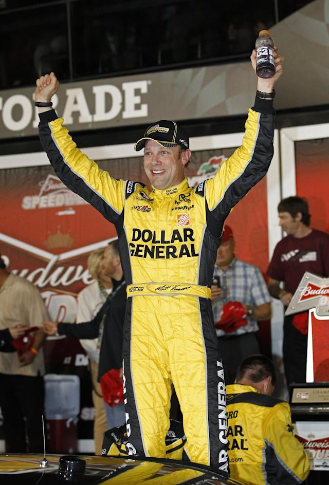 Matt Kenseth celebrates in Victory Lane after winning the first of two NASCAR Sprint Cup series qualifying auto races at Daytona International Speedway in Daytona Beach, Fla., Thursday, Feb. 20, 2014. (AP Photo/Terry Renna)
