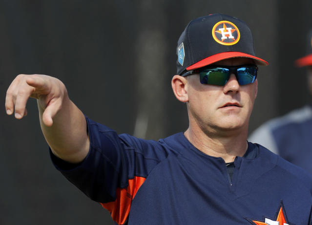 Houston Astros manager A.J. Hinch points during spring training baseball practice Thursday, Feb. 15, 2018, in West Palm Beach, Fla. (AP Photo/Jeff Roberson)