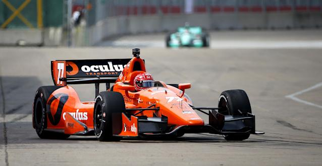 Simon Pagenaud, of France, drives through the course during a practice session for the IndyCar Grand Prix of Houston auto race Friday, June 27, 2014, in Houston. (AP Photo/David J. Phillip)