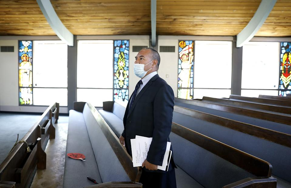 """Because of the COVID-19 pandemic, First United Methodist Church of Bellflower Pastor Kitione Tuitupou now livestreams Sunday services. <span class=""""copyright"""">(Christina House / Los Angeles Times)</span>"""