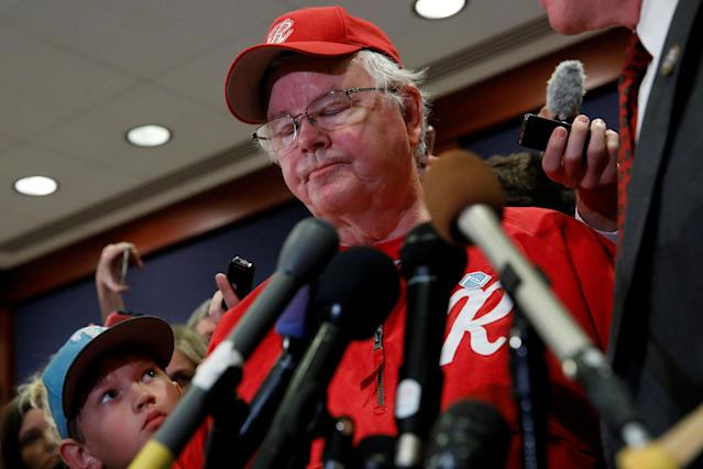 <p>Jack Barton (L), the young son of Rep. Joe Barton (R), manager of the Republican Congressional Baseball team, listens as his father speaks about the shooting that they were both present for in Alexandria, Virginia while addressing the media on Capitol Hill in Washington, June 14, 2017. (Photo: Aaron P. Bernstein/Reuters) </p>