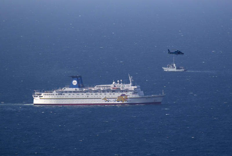 An Israeli military naval ship and an Israeli air force helicopter operate next to a cruise ship off the coast of Haifa, northern Israel, Thursday, April 25, 2013.  Israel shot down a drone Thursday as it approached the country's northern coast, the military said. Suspicion immediately fell on the Hezbollah militant group in Lebanon. The incident was likely to raise already heightened tensions between Israel and Hezbollah, a bitter enemy that battled Israel to a stalemate during a monthlong war in 2006. (AP Photo/Ariel Schalit)
