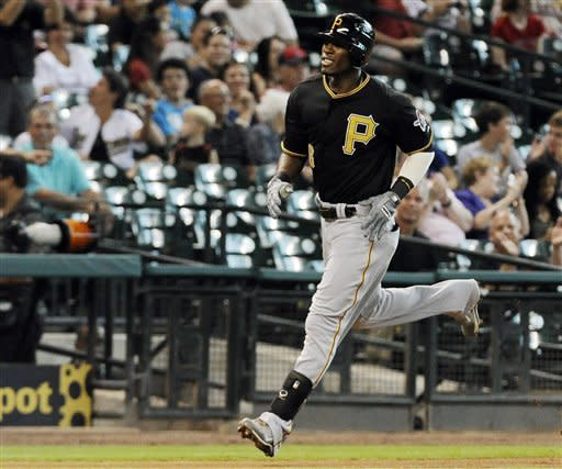 Pittsburgh Pirates' Starling Marte rounds the bases on a solo home run on the first pitch of the first inning in his first appearance with the Pirates in a baseball game, Thursday, July 26, 2012, against the Houston Astros in Houston. (AP Photo/Pat Sullivan)