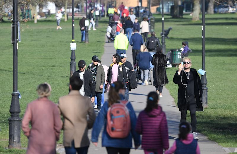 Pedestrians use a path across Clapham Common in south London, after Prime Minister Boris Johnson has said the Government is ready to impose tougher restrictions to curb the spread of the coronavirus if people do not follow the guidance on social distancing.