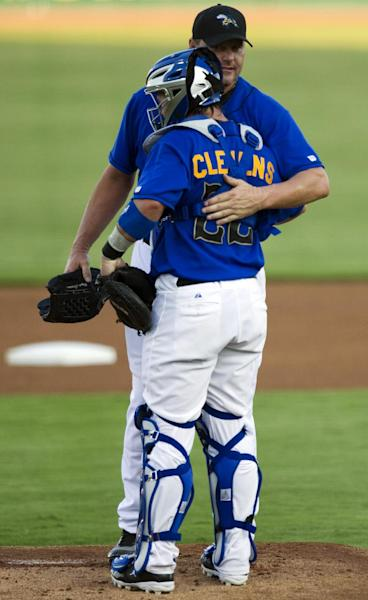 Sugar Land Skeeters starter Roger Clemens, top, embraces his son, catcher Koby Clemens (22), before his second outing for the Skeeters in a minor league baseball game against the Long Island Ducks at Constellation Field, Friday, Sept. 7, 2012, in Sugar Land, Texas. (AP Photo/Houston Chronicle, Brett Coomer) MANDATORY CREDIT