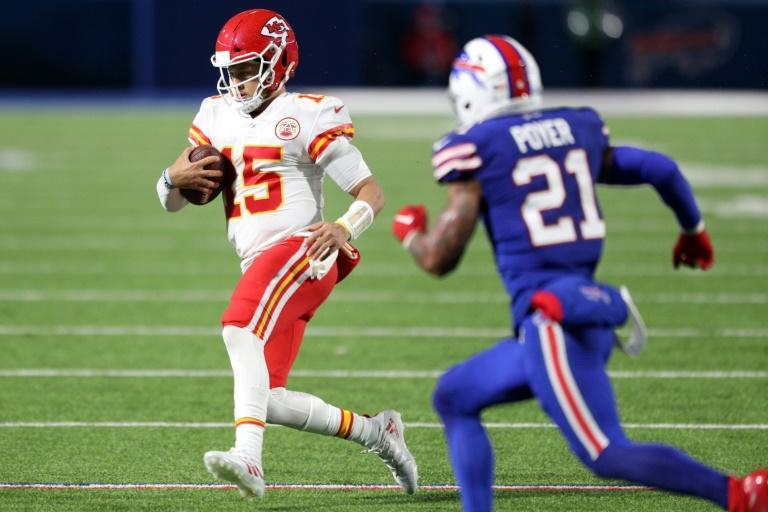 Kansas City Chiefs quarterback Patrick Mahomes runs the ball for a first down against the Buffalo Bills during the second half of their NFL game at Bills Stadium