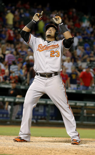 CORRECTS TO THREE-RUN HOME RUN, INSTEAD OF GRAND SLAM - Baltimore Orioles' Nelson Cruz celebrates at the plate after he hit a three-run home run in the eighth inning against the Texas Rangers in a baseball game Tuesday, June 3, 2014, in Arlington, Texas. (AP Photo/Sharon Ellman)