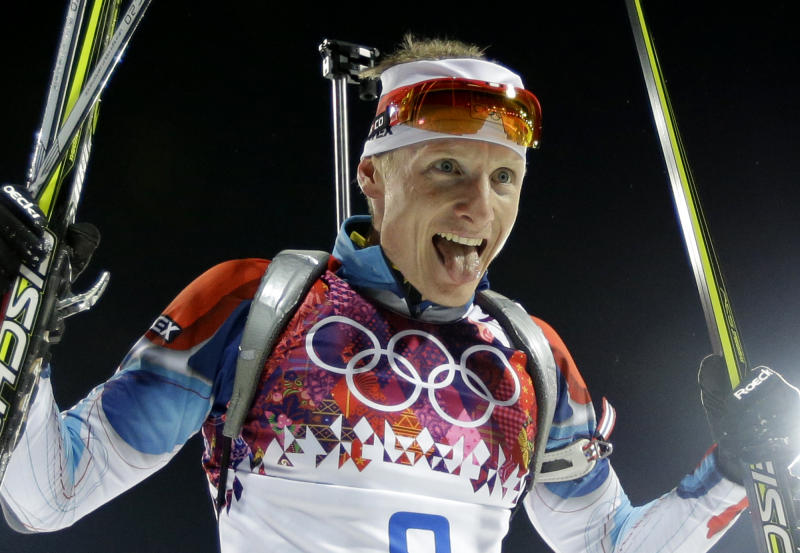 Czech Republic's Ondrej Moravec sticks his tongue out as he celebrates his silver medal in the men's biathlon 12.5k pursuit, at the 2014 Winter Olympics, Monday, Feb. 10, 2014, in Krasnaya Polyana, Russia. (AP Photo/Kirsty Wigglesworth)
