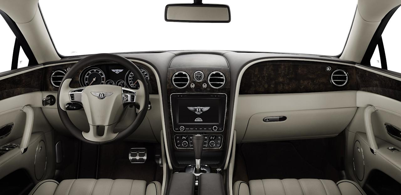 The interior of the new Flying Spur includes 600 new parts, with only the sun visors, grab handles, armrests and some of the front console and controls carried over from the previous generation.