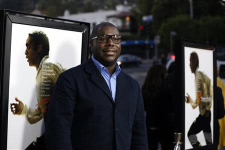 """Director and producer of the movie """"12 Years a Slave"""" Steve McQueen poses at a special screening of the movie at the Directors Guild of America in Los Angeles, California in this October 14, 2013 file photo. REUTERS/Mario Anzuoni/Files"""