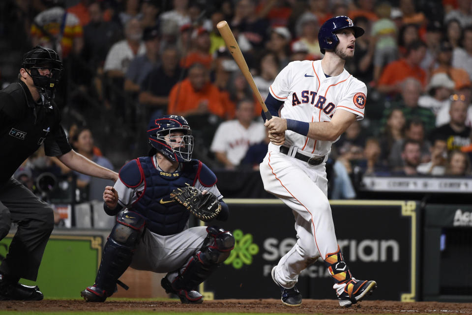 Houston Astros' Kyle Tucker, right, watches his solo home run during the fifth inning of the team's baseball game against the Cleveland Indians, Wednesday, July 21, 2021, in Houston. (AP Photo/Eric Christian Smith)