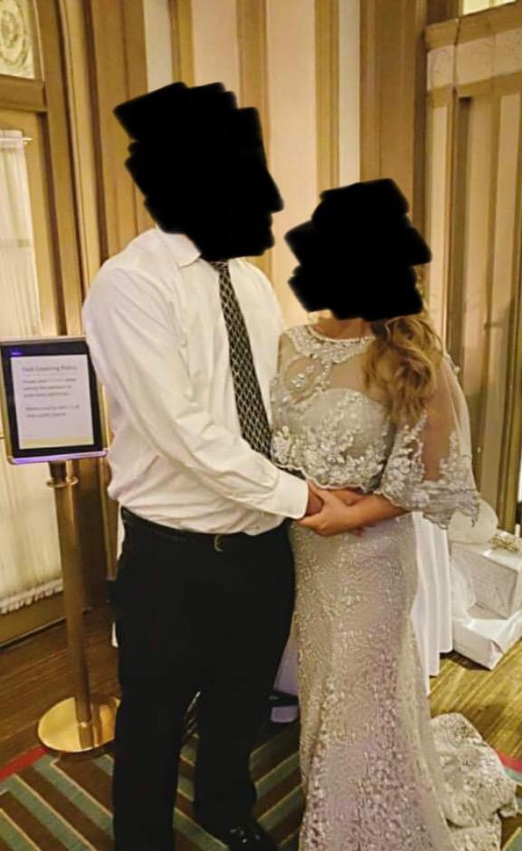A Reddit user has taken to the website to share her shock after seeing a photo of a couple at a wedding. Photo: Reddit