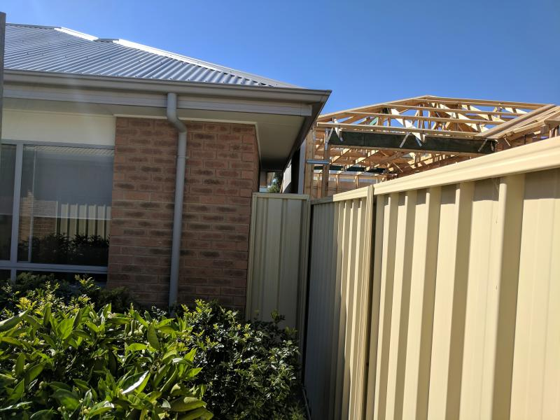 Adelaide home with gutter squashed and light blocked by new development.