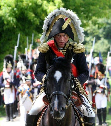 Paris Sorbonne University's professor Oleg Sokolov rides his horse on June 23 on the banks of the river Neman in Kaunas, central Lithuania, as he plays Napoleon Bonaparte during a historical reenactment of Bonaparte's June 24, 1812 assault on Tsarist Russia. The spectacular reenactment drew more than 1,000 participants from France, Russia and across the region