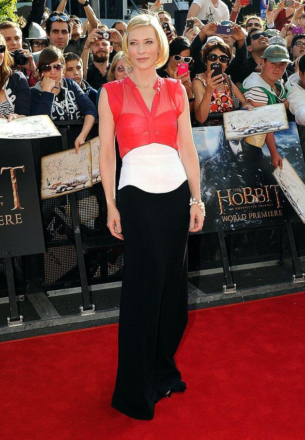 "Meanwhile in New Zealand -- at the highly anticipated premiere of ""The Hobbit"" -- Oscar winner Cate Blanchett dropped jaws in a stunning, tri-colored Antonio Berardi gown, which featured a sheer bustier. A pinned bob, glossy lips, and beaded bracelet completed her flawless ensemble. (11/28/2012)"