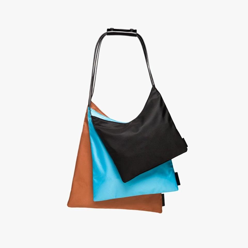 """With masks and hand sanitizers as the new essentials to keep on hand, a bag with multiple pouches can come in handy (and hygienic). $195, BANDIER. <a href=""""https://www.bandier.com/products/multi-pouch-black"""" rel=""""nofollow noopener"""" target=""""_blank"""" data-ylk=""""slk:Get it now!"""" class=""""link rapid-noclick-resp"""">Get it now!</a>"""