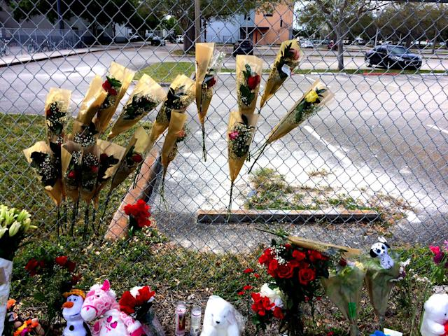 <p>Roses are seen on a fence line outside Marjory Stoneman Douglas High School , Feb. 19, 2018 in Parkland, Fla. (Photo: Mindy Katzman/Yahoo News) </p>