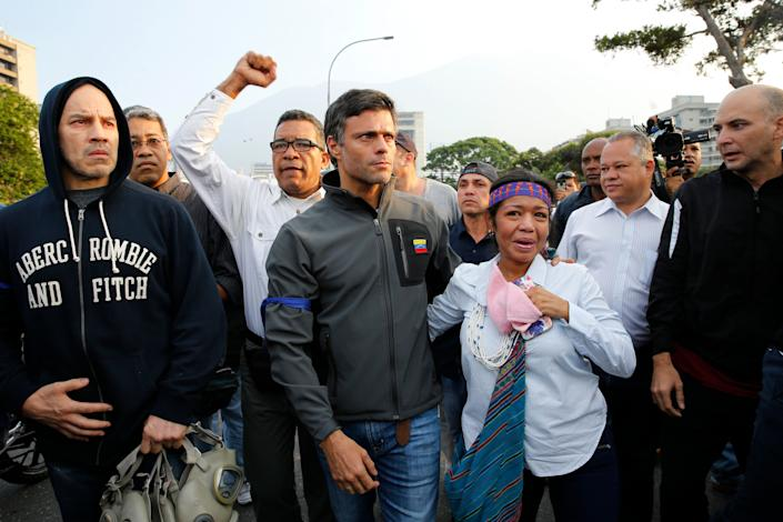 Opposition leader Leopoldo Lopez, center, is seen surrounded by supporters outside La Carlota air base in Caracas, Venezuela, Tuesday, April 30, 2019. Lopez, who had been under house arrest for leading an anti-government push in 2014, said he had been freed by soldiers and called for a military uprising. (Photo: Ariana Cubillos/AP)