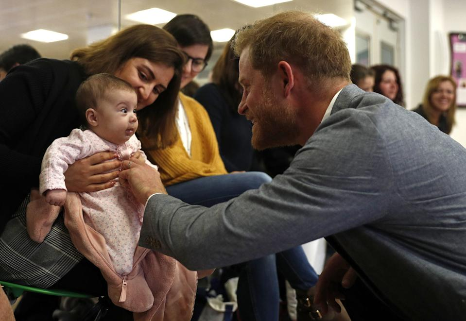 prince harry meets baby