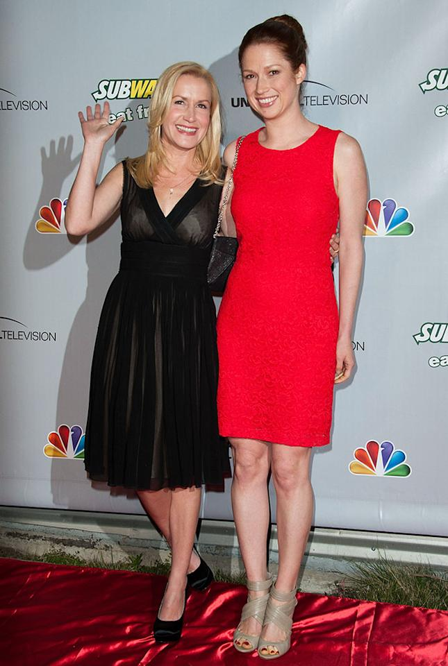 """Angela Kinsey and Ellie Kemper arrive at """"The Office"""" series finale wrap party at Unici Casa Gallery on March 16, 2013 in Culver City, California."""